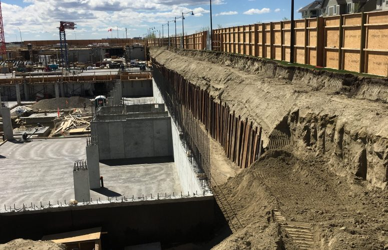 A 16' tall shoring wall installed along the edge of a large commercial project in Calgary, AB.